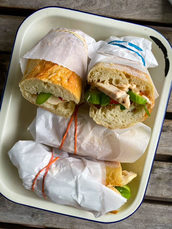 Luang Prabang Chicken-Chili Sandwiches from Everyday Dorie wrapped in parchment and secured with an elastic band.