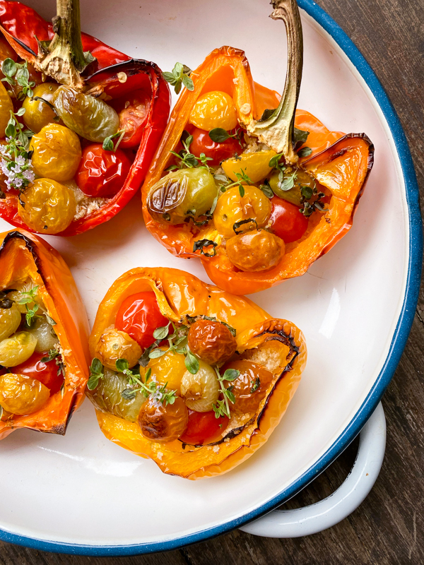 Oven-Charred Tomato-Stuffed Peppers from Everyday Dorie in a baking dish.