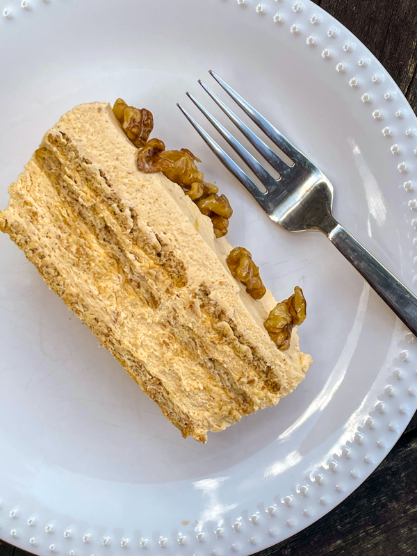 A slice of No-bake Pumpkin Cheesecake Icebox Cake on a plate with a fork.